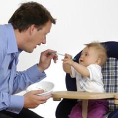 Dad-feeding-baby